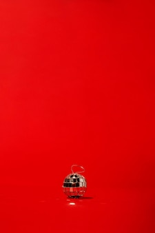 Disco ball on red table
