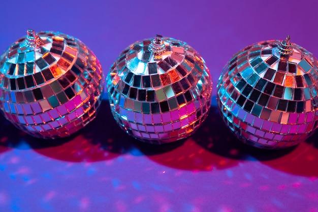 Disco ball shines on purple  close up
