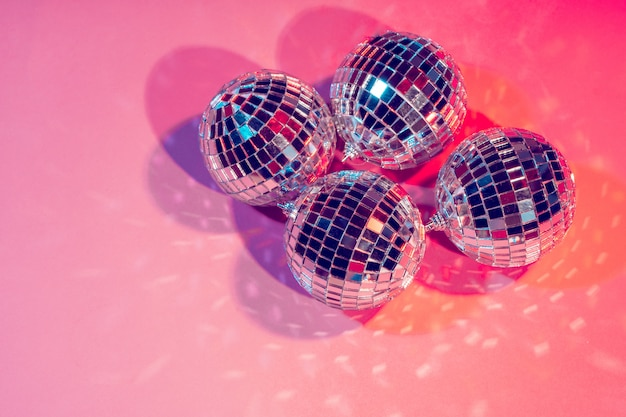 Disco balls for decorationof a party on pink