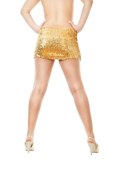 Disco woman in a golden skirt isolated.