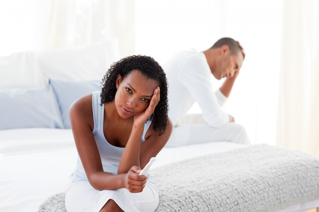 Disconcerted couple finding out results of a pregnancy test
