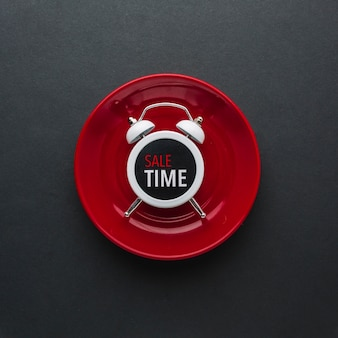 Discount alarm clock in flat lay