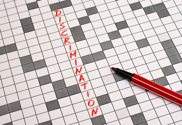 Discrimination. text in crossword. red letters