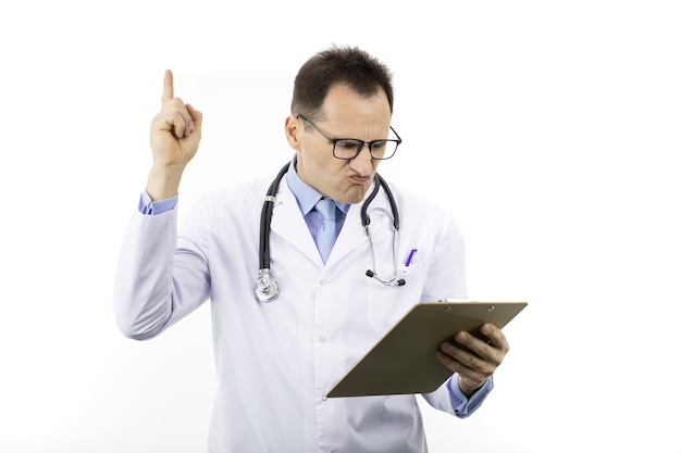 Disgruntled doctor holds thumb up looking on clipboard with patient's diagnosis