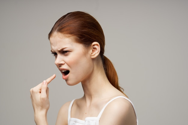 Disgruntled woman toothache health problems disorder studio treatment. high quality photo