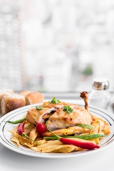 Dish of chicken fillet and different vegetables
