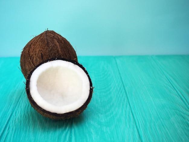 Dish of coconut milk with a split fresh coconut.