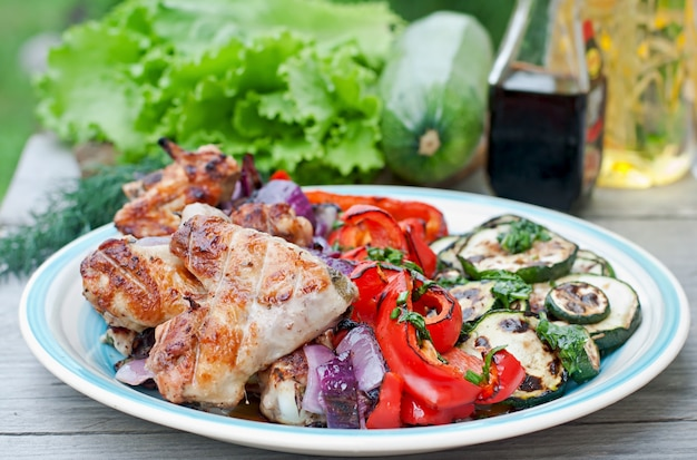 Dish of grilled vegetables (zucchini, bell pepper, red onion)
