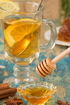 Dish of honey whit wooden spoon.