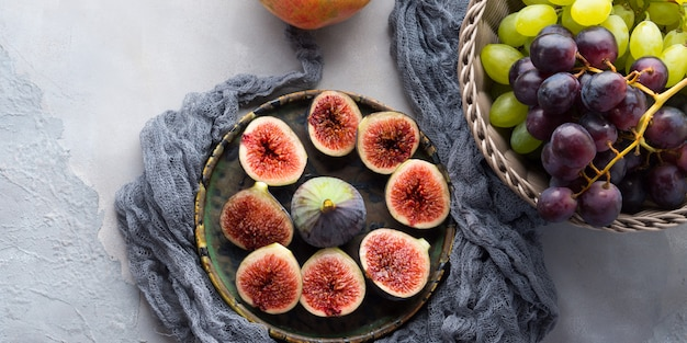 Dish of purple figs, grapes and pomegranate