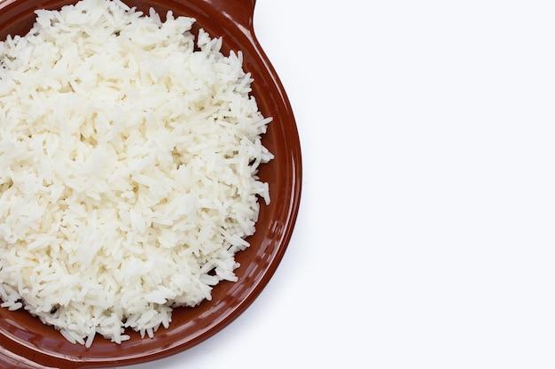 Dish of rice on white background.