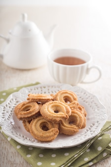 Dish with donuts and a cup of coffee