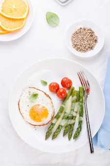 Dish with fried eggs and asparagus