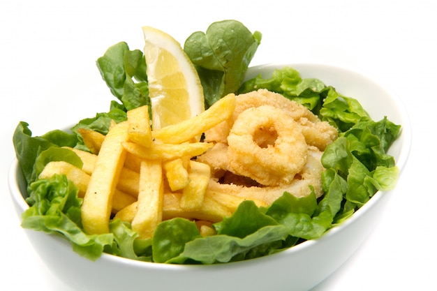 Dish with fried squid and fried potatoes