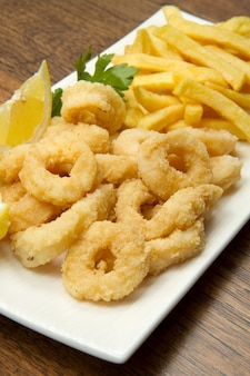 Dish with fried squid with french fries
