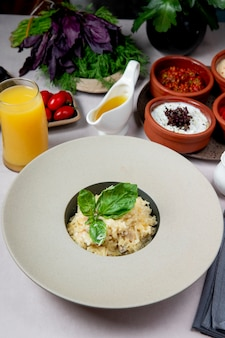 Dish with grated cheese and greens served with juice