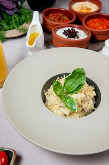 Dish with grated cheese and herbs