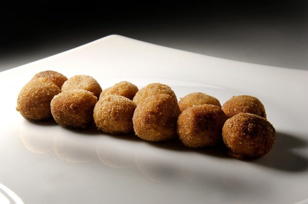 Dish with round croquettes