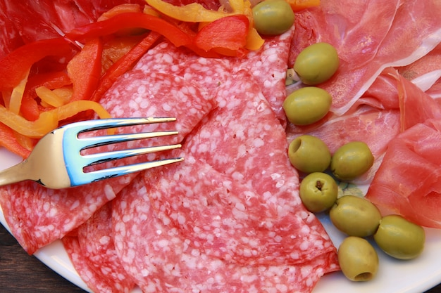 Dish with salami,ham and appetizers