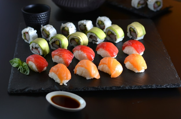 Dish with various types of sushi, some of bluefin tuna and other salmon