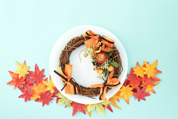 Dish with wreaths and autumn leaves decorative