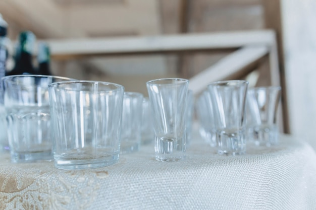 Dishes on banquet tables, serving glasses, spoons and plates