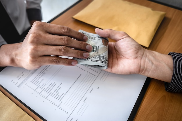 Dishonest cheating in business illegal money, businessman receive bribe money to business people to give success the deal contract of investment, bribery and corruption concept