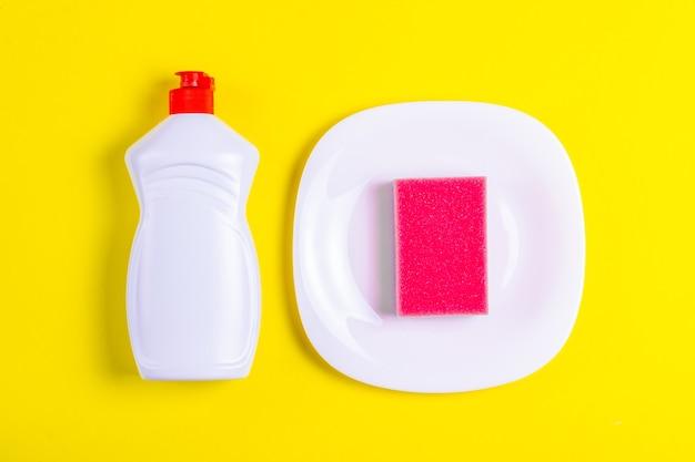 Dishwashing liquid, plate and pink sponge
