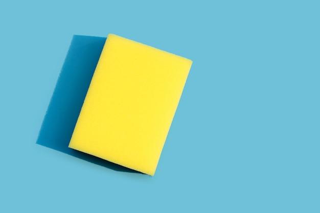 Dishwashing sponge on blue background. top view