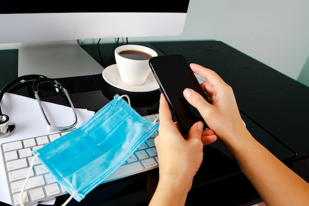 Disinfection of a computer keyboard with an antiseptic. disinfecting workplace concept.