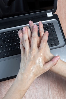 Disinfection of hands with hydrogel on work table