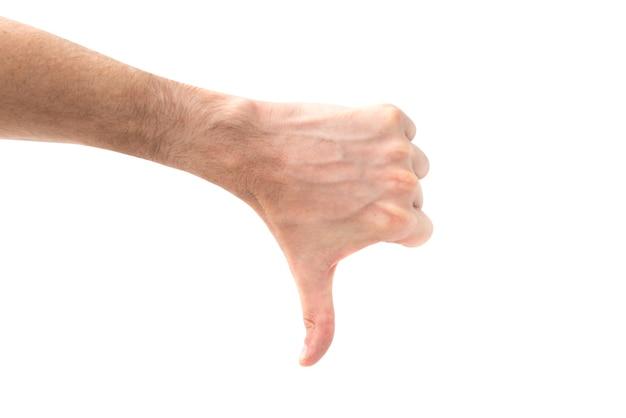 흰색 배경에 고립 된 아래로 엄지 손가락으로 손을 싫어