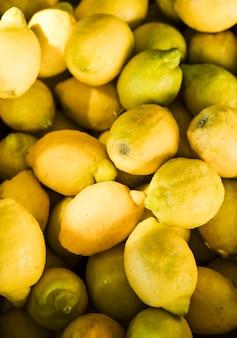 Display of fresh organic yellow lemons in fruit market