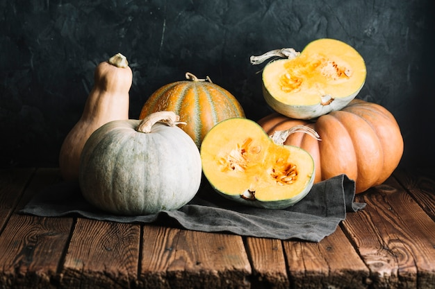 Display of pumpkins and squash on a wooden table