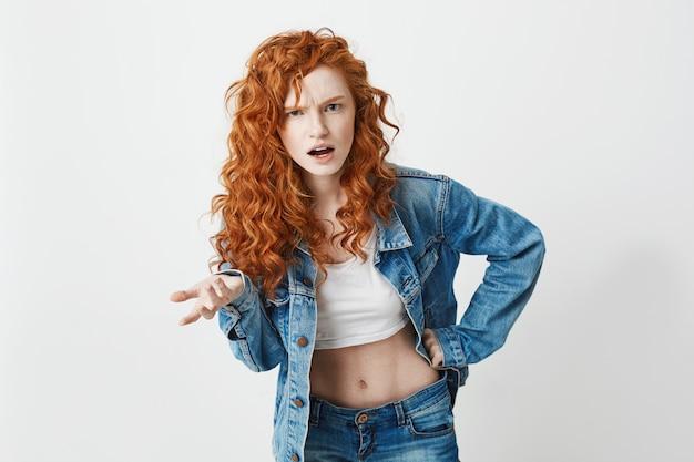 Displeased brutal redhead girl not understanding . copy space.