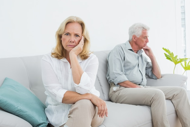 Displeased relaxed senior couple at home