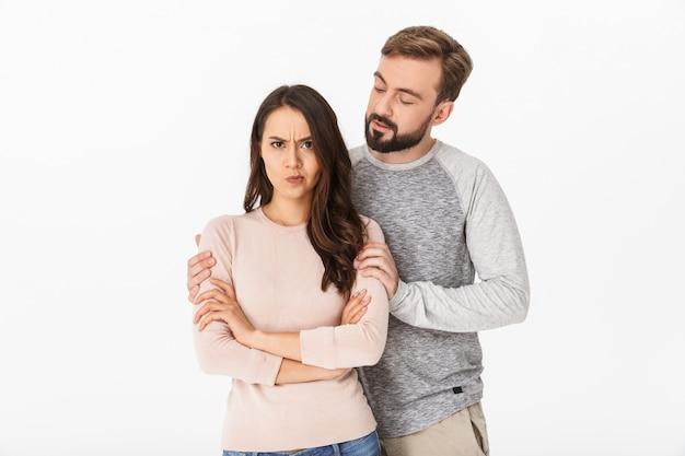 Displeased young loving couple quarrel.