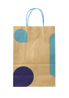 Disposable brown craft paper bag with handles isolated on a white surface, close up
