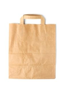 Одноразовый бумажный мешок крупным планом, изолированные на белом фоне