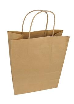 使い捨ての紙袋。白い背景の上の紙袋。パッケージ分離。