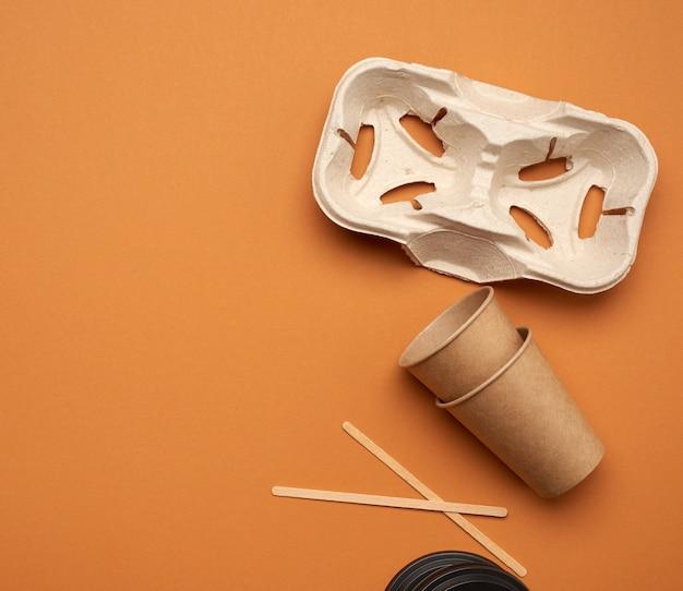 Одноразовые бумажные стаканчики из крафт-бумаги коричневого цвета