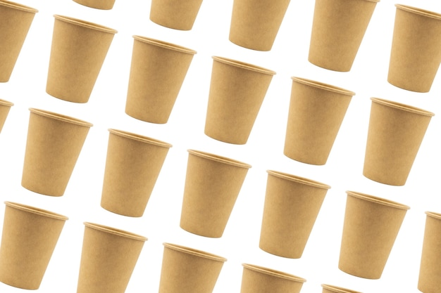 Disposable paper cups made of thick cardboard isolated and duplicated on a white background