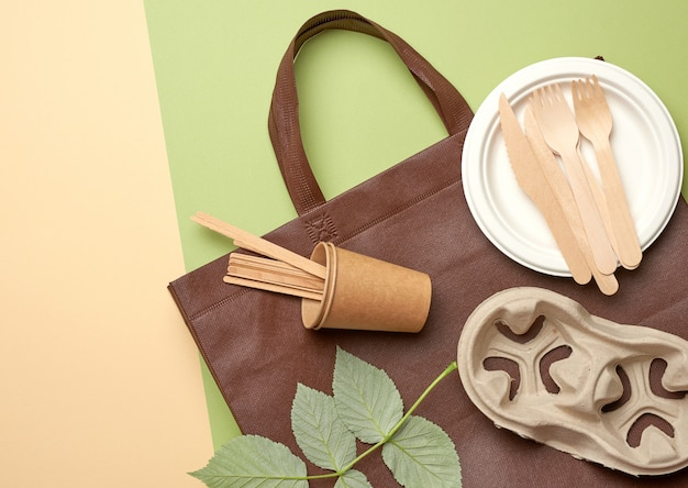 Disposable paper utensils from brown craft paper and recycled materials