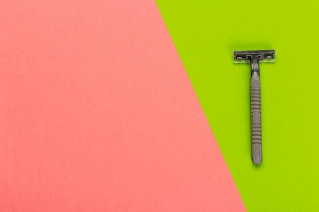 Disposable razor on a bright bicolored, top view