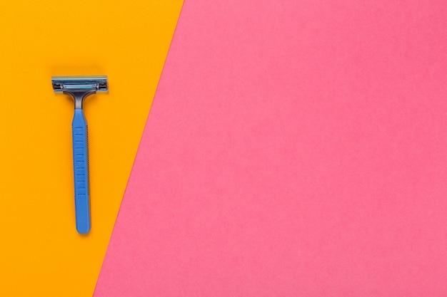 Disposable razor on a bright bicolored