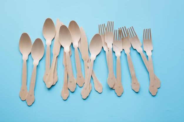 Disposable tableware from natural wooden materials, spoon, knife, and fork, eco-friendly for picnic.