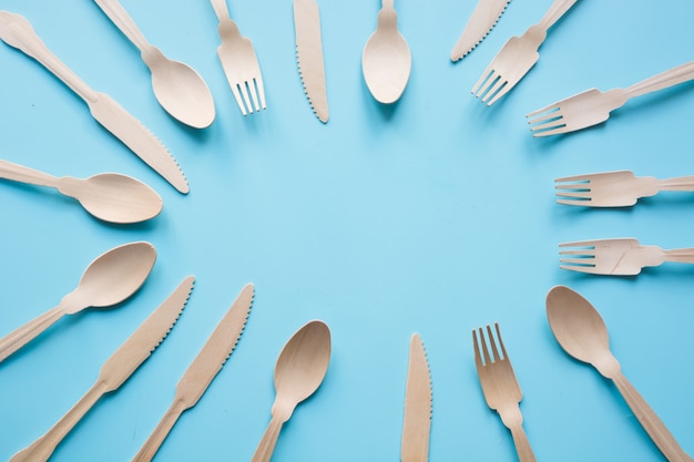 Disposable tableware from natural wooden materials, spoon, knife, and fork, eco-friendly. space for text.