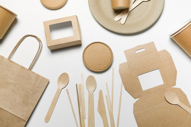 Disposable tableware made of bamboo wood and paper, on white