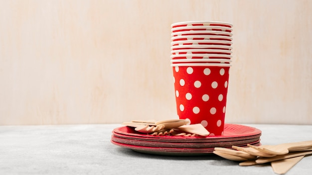Disposable tableware pile of red with white dots cups