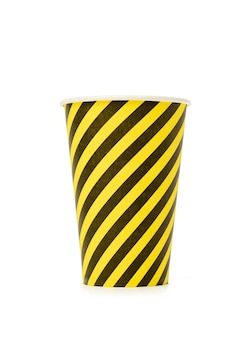Disposable yellow striped cup isolated on white background, zero waste